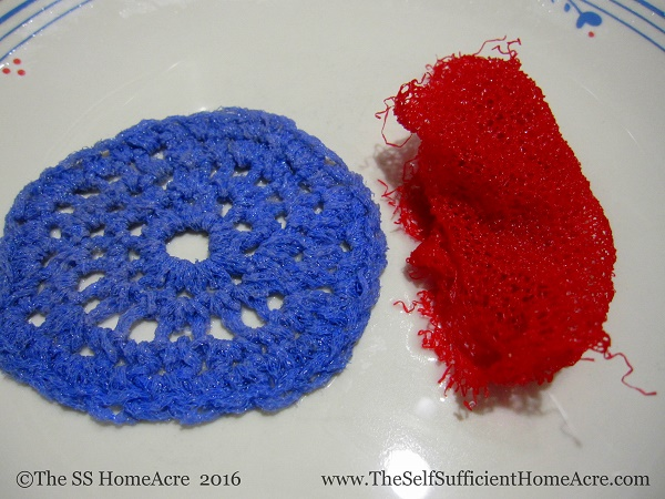 Nice, neat crocheted scrubby pad on the left...Lazy Lisa's wadded up netting scrubby on the right. In case you were wondering.