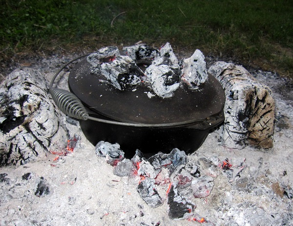Dutch oven in a bed of coals.