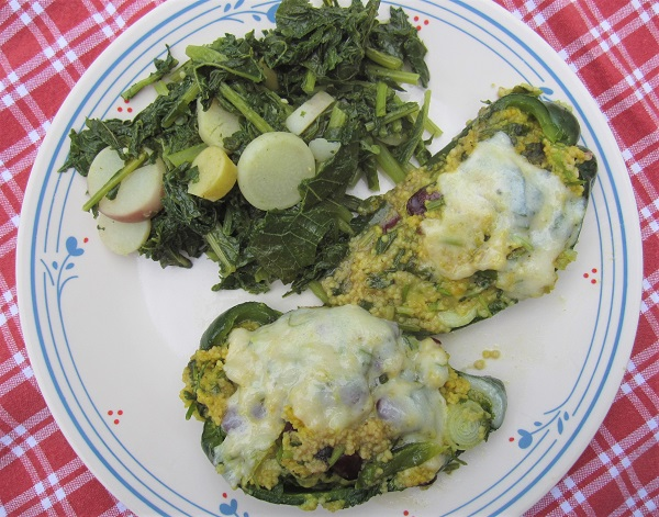 Stuffed Poblano Peppers with turnip greens on the side.
